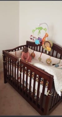 Baby's brown wooden crib Vaughan, L6A 4M5