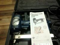 black and gray Makita cordless power tool with case Erie, 16505