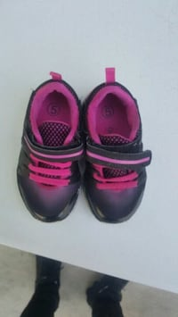 pair of black-and-pink Nike sneakers Albuquerque, 87105