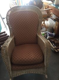 brown wicker framed brown padded armchair Palm Harbor, 34683