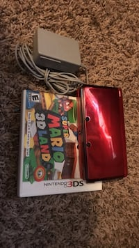 red Nintendo 3DS console and Super Mario 3D land game case