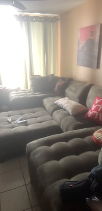 Black leather tufted sectional sofa North Miami Beach, 33179