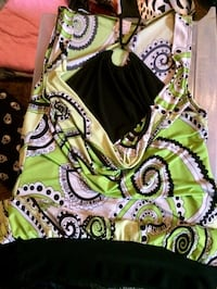 green, white, and black floral sleeveless dress