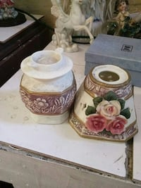 white and pink floral candle holders