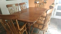 oval brown wooden table with six chairs dining set Oshawa, L1J 1S9