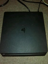 PlayStation 4 Game system, includes 2 controllers