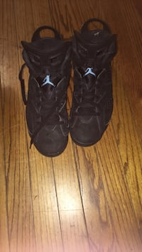 pair of black Air Jordan 8's 42 km