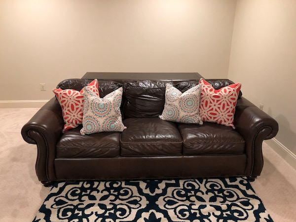 Brown leather couch with pullout sleeper