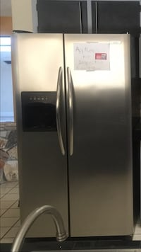Stainless steel fridge and stove electric ice water on fridge door great condition $600 cash both or $300 each cash firm  34607