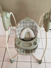 Graco green and beige motorized swing with music