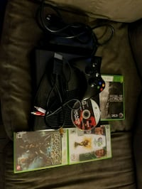 Xbox 360 console with controller and game cases Edmonton, T5W 2V6