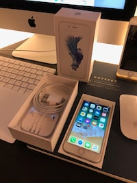 gold iPhone 6s with charger, EarPods, and box