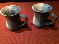 Two blue-and-white ceramic mugs