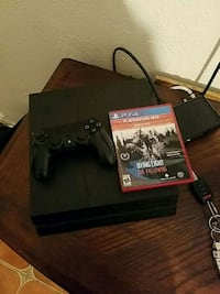 black Sony PS4 console with controller and game case Miami, 33169