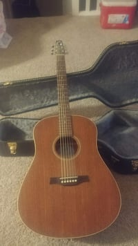 brown wooden acoustic guitar