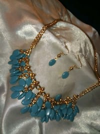 gold-colored necklace with blue gemstone pendant SeaTac, 98188