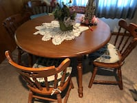 Tell City Dining Room Table with 6 chairs ( including one captain chair) and 2 inserts. Fishers, 46038