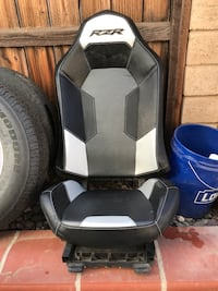 black and white Rzr leather car seat