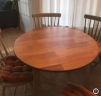 round brown wooden table with four chairs dining set Alexandria, 22310