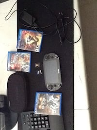 black Sony PS4 console with controller and game cases Kitchener, N2R 1Y2