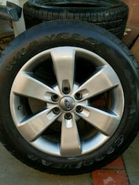 black and gray Ford wheel
