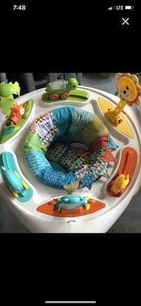 Sit, spin, & stand activity seat & table with double sided foot mat