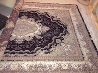 White and brown floral area rug ??????