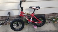 Kid's red and black Huffy bicycle