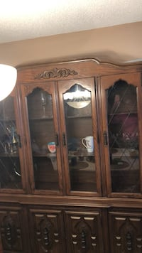 brown wooden framed glass display cabinet Whitby, L1P 1L2