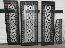 heavy wrought iron doors with glass