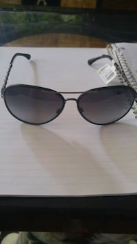 black framed aviator-style sunglasses Toronto, M4L