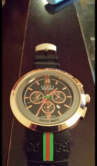 round silver-colored chronograph watch with black leather strap null