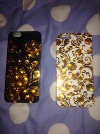 two black and yellow iPhone cases