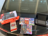 Nintendo Switch, case, screen protector, and 5 games including Super Smash Bros Germantown