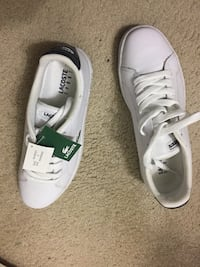 pair of white Adidas low-top sneakers Raleigh
