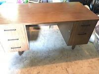Desk with large workspace and plenty of drawers