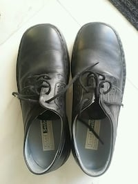 pair of black leather dress shoes Calgary, T3H 2M1
