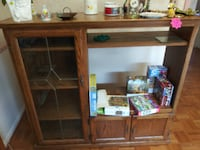 TV Entertainment Center Solid Oak Wood -Brown Media Wall Unit Cabinet Retail:$300.  Condition is Used. Local pickup only. LIVONIA