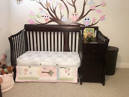 Black wooden crib with changing table