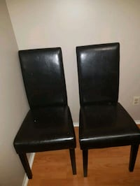 two black leather padded chairs London, N6E 2H7