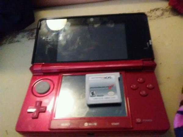 red and black Nintendo 3DS