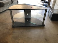rectangular glass-top table with black wooden base Victorville, 92395