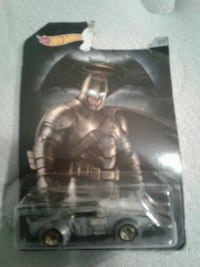 black and gray Batman car die-cast car with pack