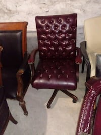 brown wooden frame black leather padded armchair Baltimore, 21217