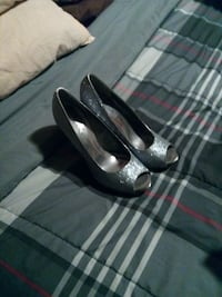 pair of silver peep-toe heeled shoes