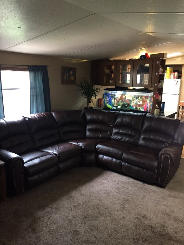 Used black leather sectional sofa with ottoman for sale in Sioux ...