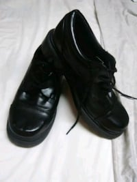 pair of black leather shoes Hendersonville, 28739