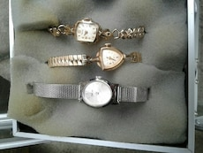 three assorted analog watches in box