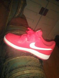 unpaired red and white Nike SB low