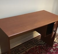 brown wooden single pedestal desk Dollard-des-Ormeaux, H9A 3J6